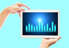 Business woman shows a tablet with a sales graph. Financial and bank technology concept stock photo