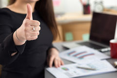 Business woman shows thumb up Stock Photos