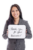 Business woman with sign. A late 30s business woman holding Thank You for your Business sign isolated on a white background Stock Photo