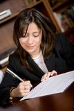 Business woman signing a contract Royalty Free Stock Images