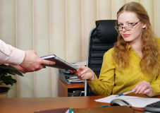Business woman signing a contract. Stock Photos