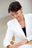 Business woman signing a contract Royalty Free Stock Image