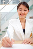 Business woman signing a contract Stock Images