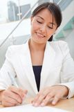 Business woman signing a contract Stock Photo