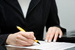Business woman signing contract Royalty Free Stock Image