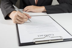 Business woman signing contract document form Stock Photos