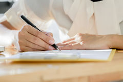 Business woman signing a contract document making a deal. Stock Image