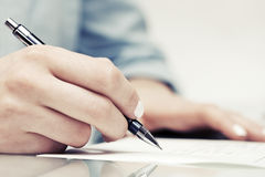 Business woman signing contract Stock Photo