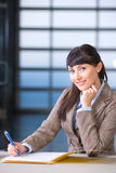 Business Woman signing documents Stock Photo