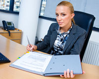 Business woman signing documents Stock Image