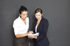 Business woman signing documents Stock Images