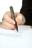 Business woman signing a letter Royalty Free Stock Images