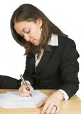 Business woman signing papers Royalty Free Stock Photography