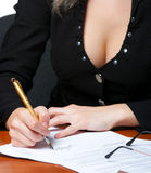 The business woman signs the contract Stock Image