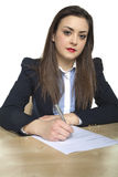 Business woman signs a contract Royalty Free Stock Images