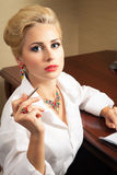Business woman signs documents Royalty Free Stock Image