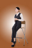 Business woman sit on a chair Stock Images