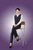 Business woman sit on a chair Stock Photos