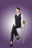 Business woman sit on a chair Stock Image