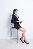Business woman sit. With digital tablet pc computer with white wall background, great for your design or text, asian beauty Royalty Free Stock Photo