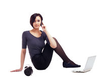 Business woman sit with laptop talk on cell Stock Image
