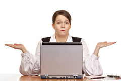 Business woman sits on desk and works on laptop Stock Photo
