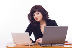 Business woman sits in front of computer Royalty Free Stock Photo