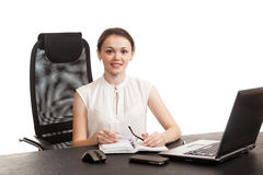 The business woman sits at office table Royalty Free Stock Images