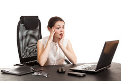The business woman sits at office table Stock Photo