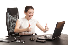 The business woman sits at office table Stock Image
