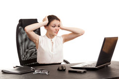 The business woman sits at office table Stock Photography