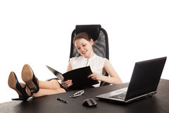 The business woman sits at office table Royalty Free Stock Photography