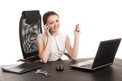 The business woman sits at office table Stock Photos