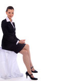 Business woman sitting. On the chair royalty free stock image