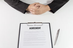 Business Woman sitting with agreement in front of her Royalty Free Stock Photo