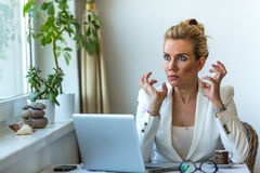 Business woman sitting angry with laptop. Stress. Royalty Free Stock Image