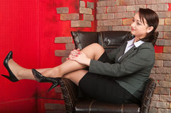 Business woman sitting in armchair Royalty Free Stock Images