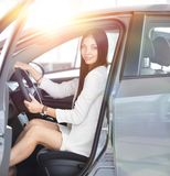 Modern business woman sitting behind the wheel of a car,in the Parking. Business woman sitting behind the wheel of a car,in the Parking lot at the car dealership royalty free stock image