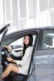 Modern business woman sitting behind the wheel of a car,in the Parking. Business woman sitting behind the wheel of a car,in the Parking lot at the car dealership stock photo