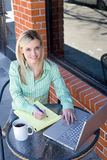 Business Woman sitting at a cafe working Stock Photos