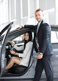 Business woman sitting in the car,in the Parking lot at the car dealership. Stock Image
