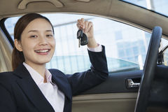 Business Woman Sitting In Car, Showing Keys, Vehicle Interior Royalty Free Stock Image