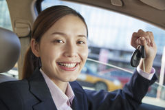 Business Woman Sitting In Car, Showing Keys, Vehicle Interior Stock Photo