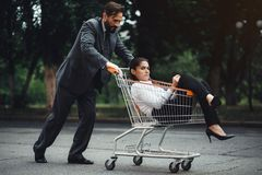 Business woman sitting in cart royalty free stock photography