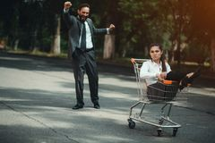 Business woman sitting in cart royalty free stock image
