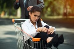 Business woman sitting in cart stock photos
