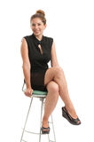 Business woman sitting on a chair Stock Images