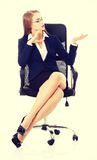 Business woman sitting on a chair and advertising. Stock Photo