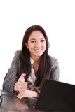 Business woman sitting on chair at desk in office. And pointing to you:yes,you Royalty Free Stock Photos