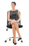 Business woman sitting on a chair Stock Photography